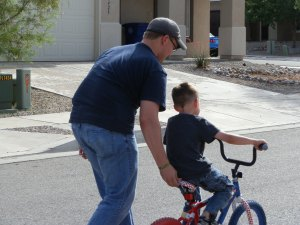 The Ministry Papa helping our son, Dos, learn to ride his bike without training wheels.